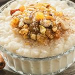 Instant pot vegan coconut rice pudding recipe. Delicious dessert cooked in an instant pot and served with nuts and ground cinnamon. #instantpot #pressurecooker #dessert #rice #pudding #vegan #vegetarian #homemade