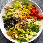 Slow cooker beef chicken taco salad recipe. Chicken breasts with beer and spices cooked in a slow cooker and served with yummy homemade Cilantro Vinaigrette. #slowcooker #crockpot #chicken #dinner #taco #beer #mexican #homemade